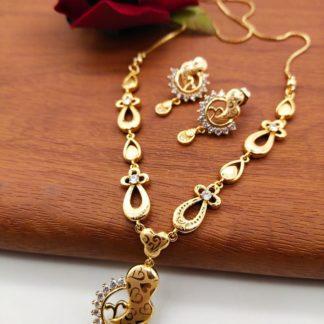 Mind-Blowing White Diamond Golden Artificial Necklace Set Design